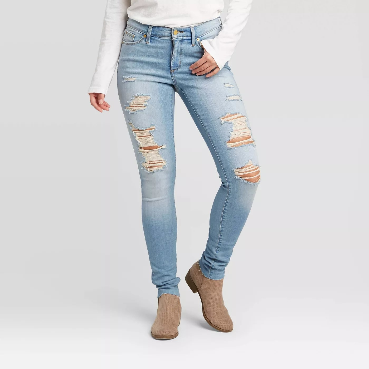 A model wearing distressed, light-wash jeans