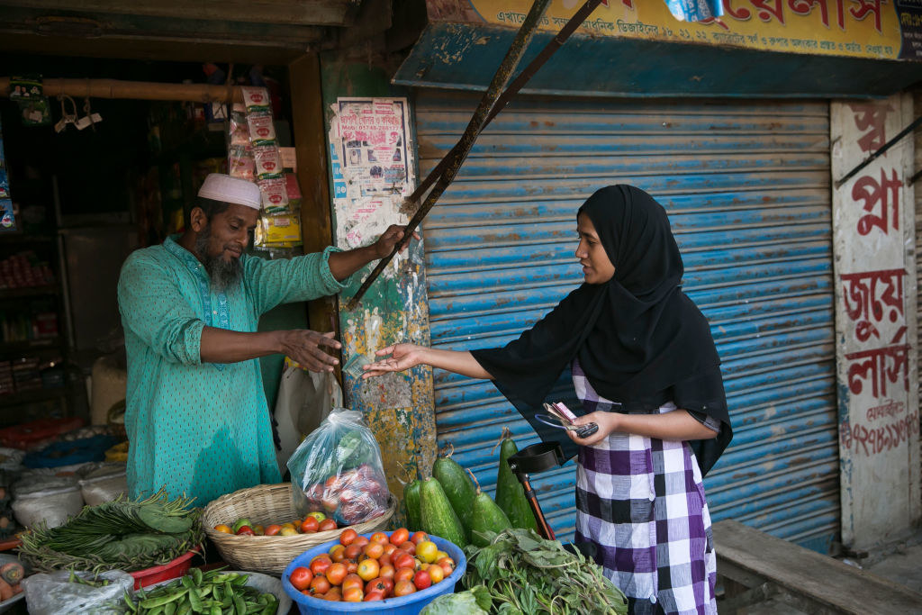 An exchange at a market in Dhaka