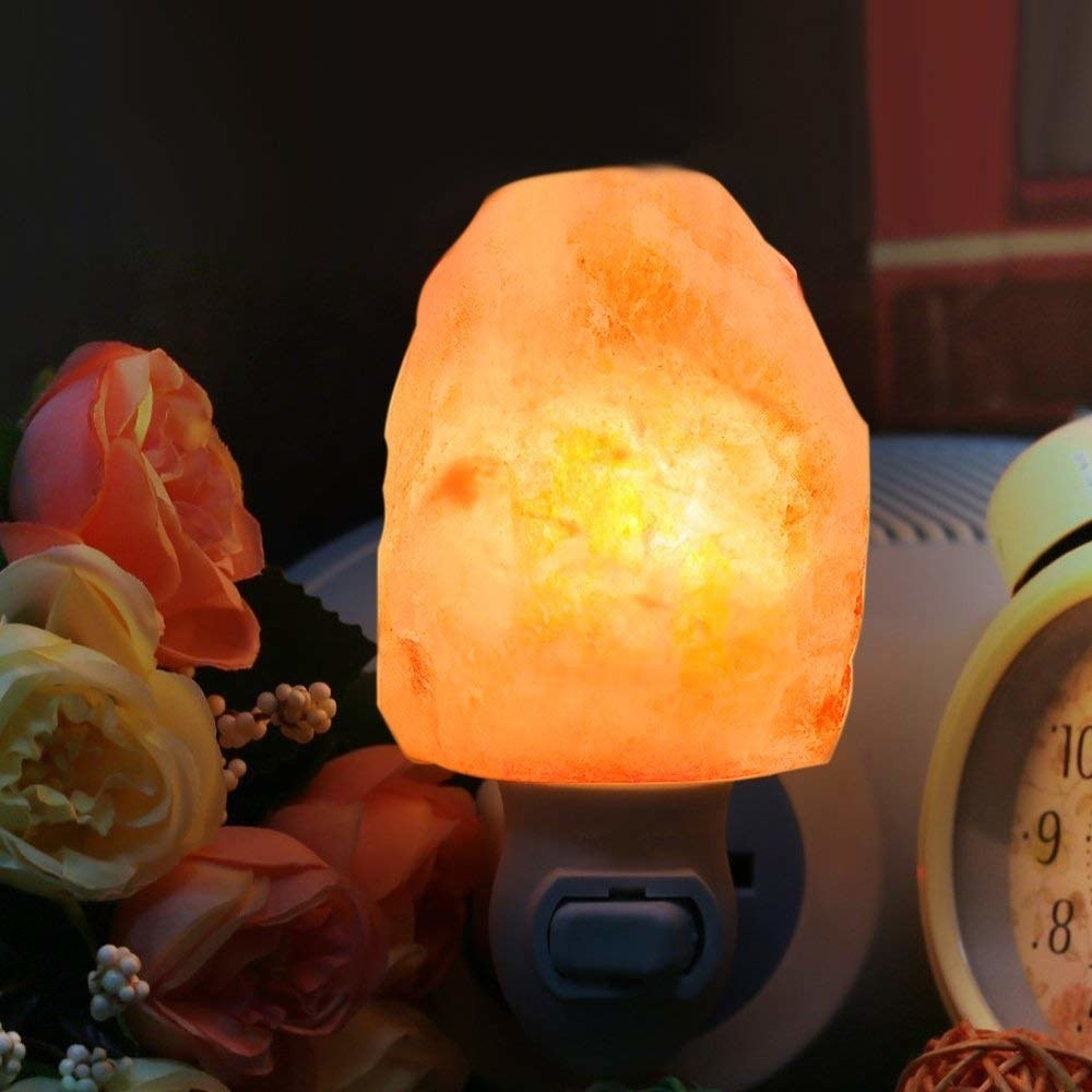 Himalayan salt crystal nightlight plugged in and on