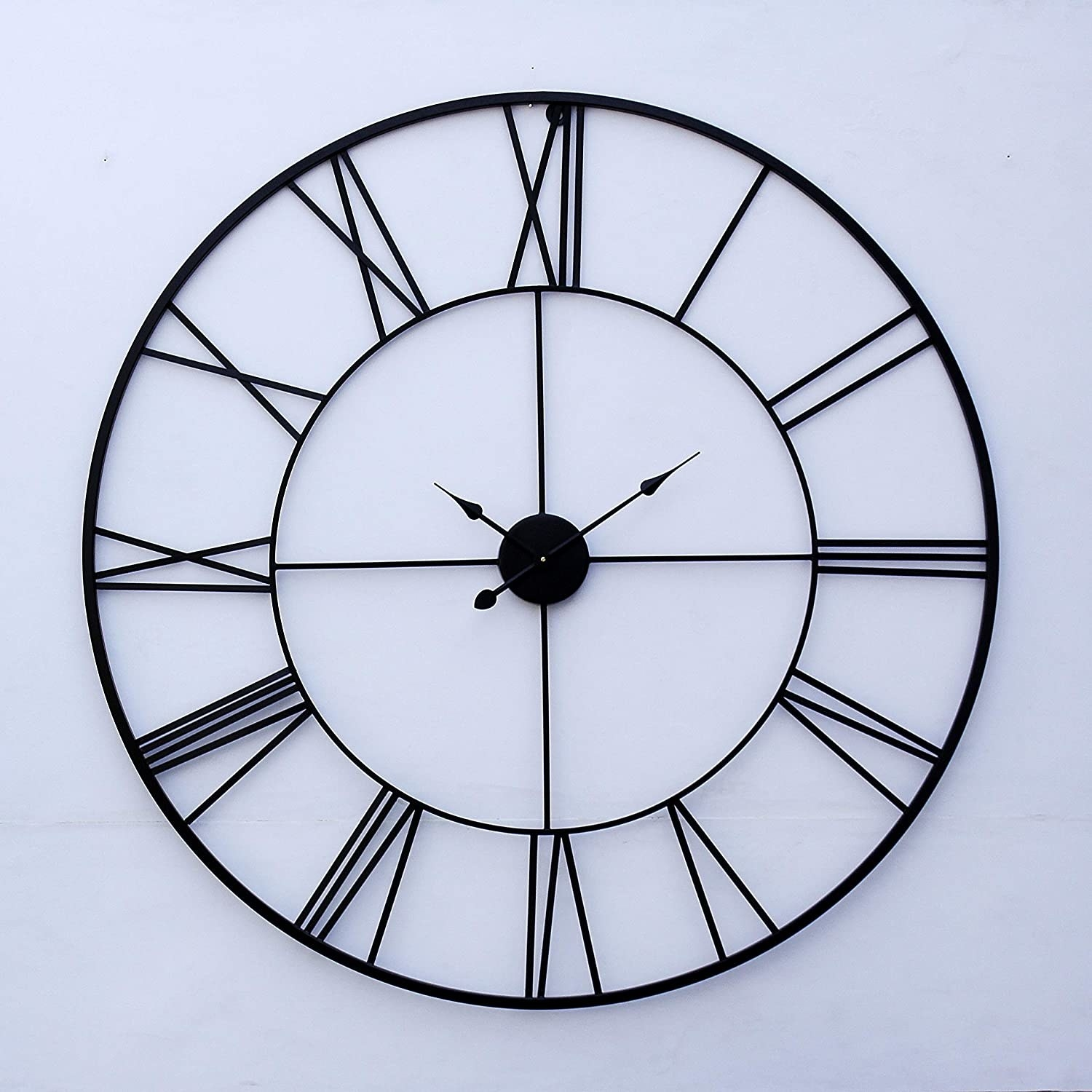 A black wall clock with Roman numerals.