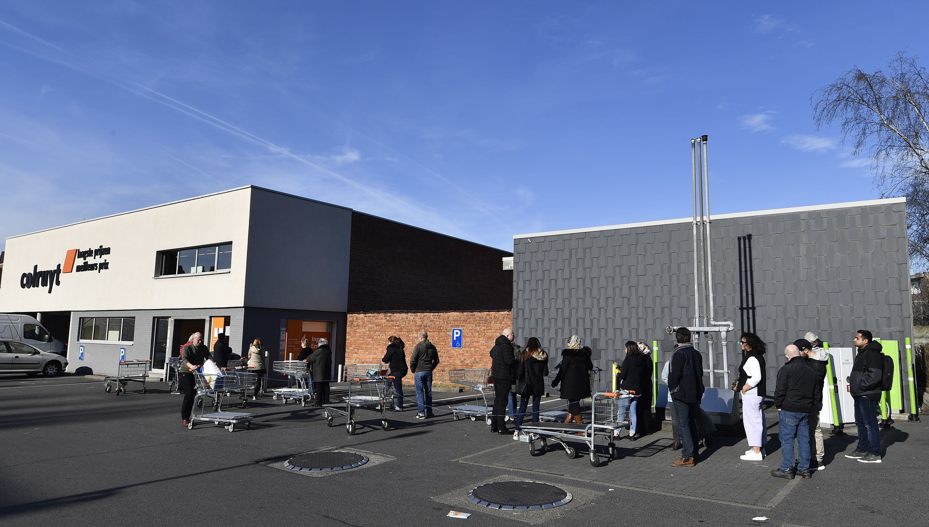 The line in the parking lot of a Colruyt supermarket
