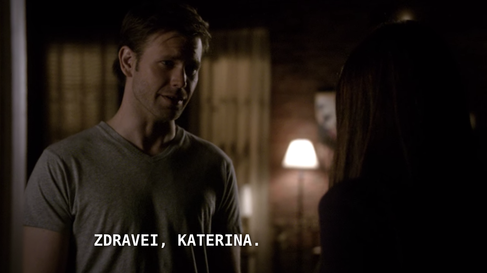 Klaus — in Alaric's body — greeting Katherine in a foreign language.