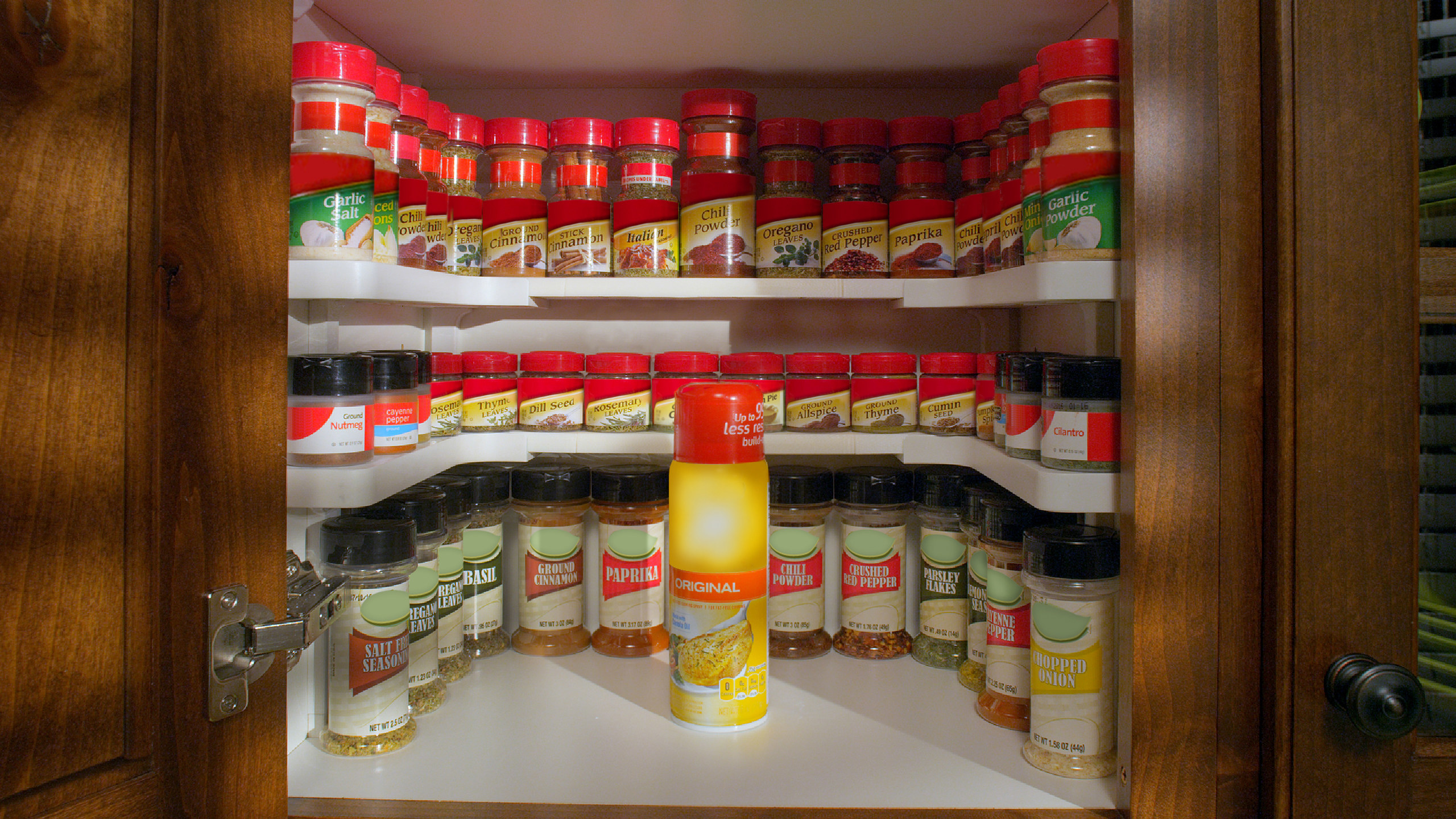 spicy shelf organization system with spice jars on it