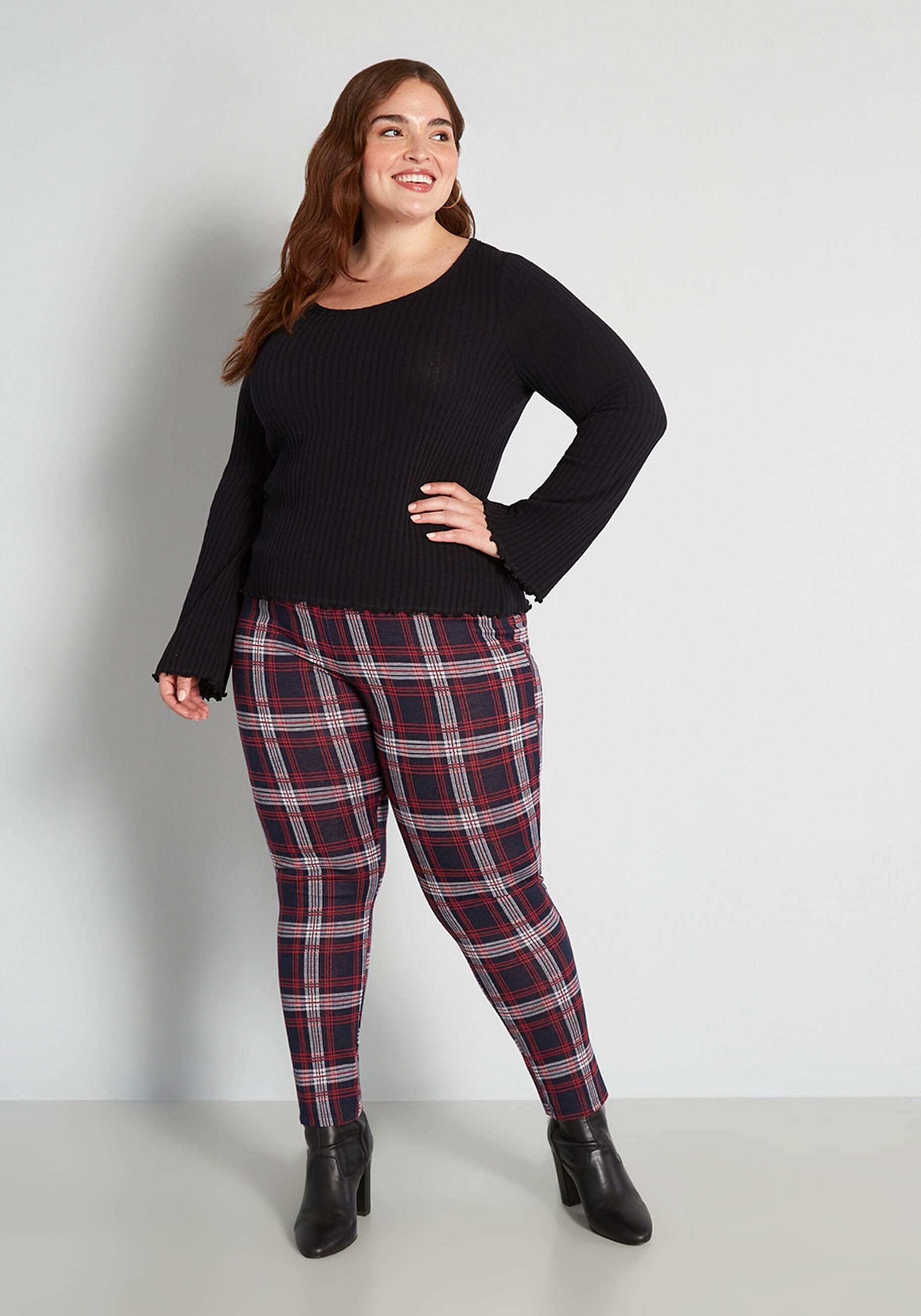 a model in red and blue plaid leggings