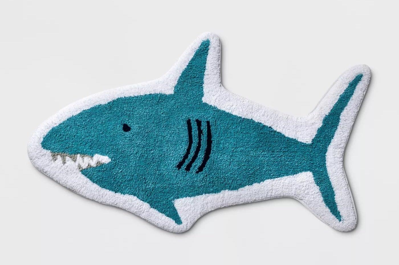A blue shark bath rug