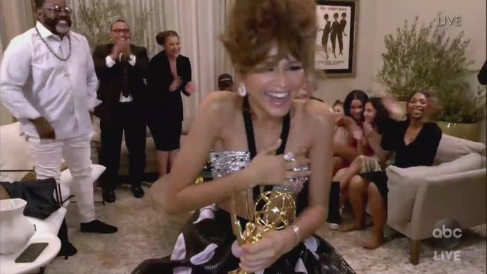 Zendaya accepting her Emmy surrounded by family