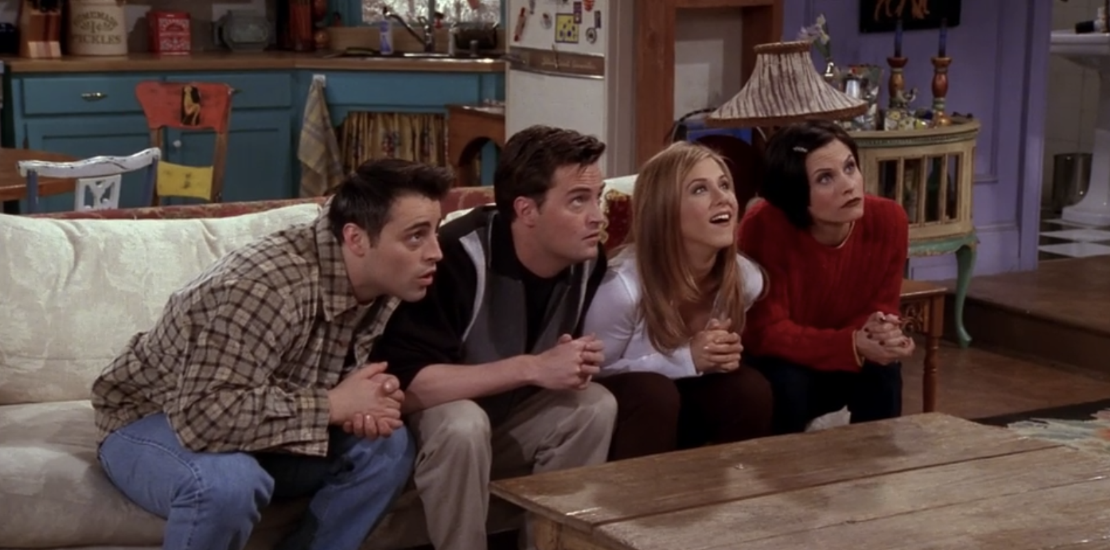 Joey, Chandler, Rachel, and Monica stare blankly at Ross