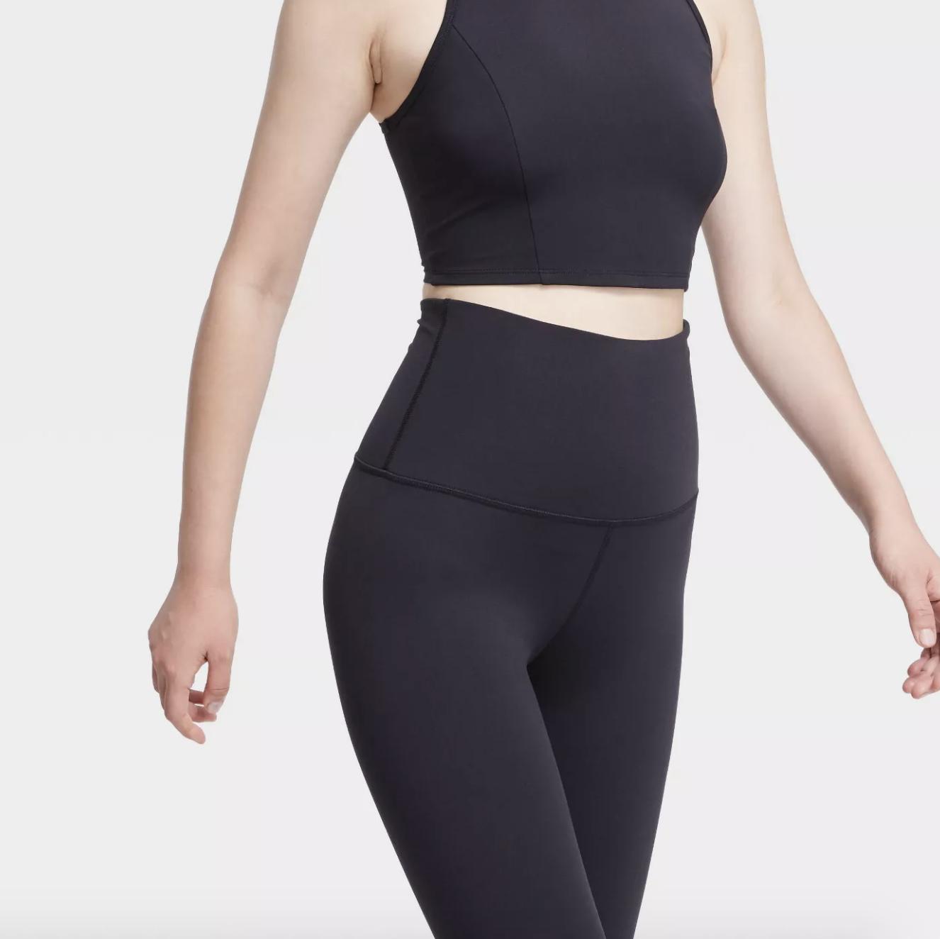 a model in the black leggings