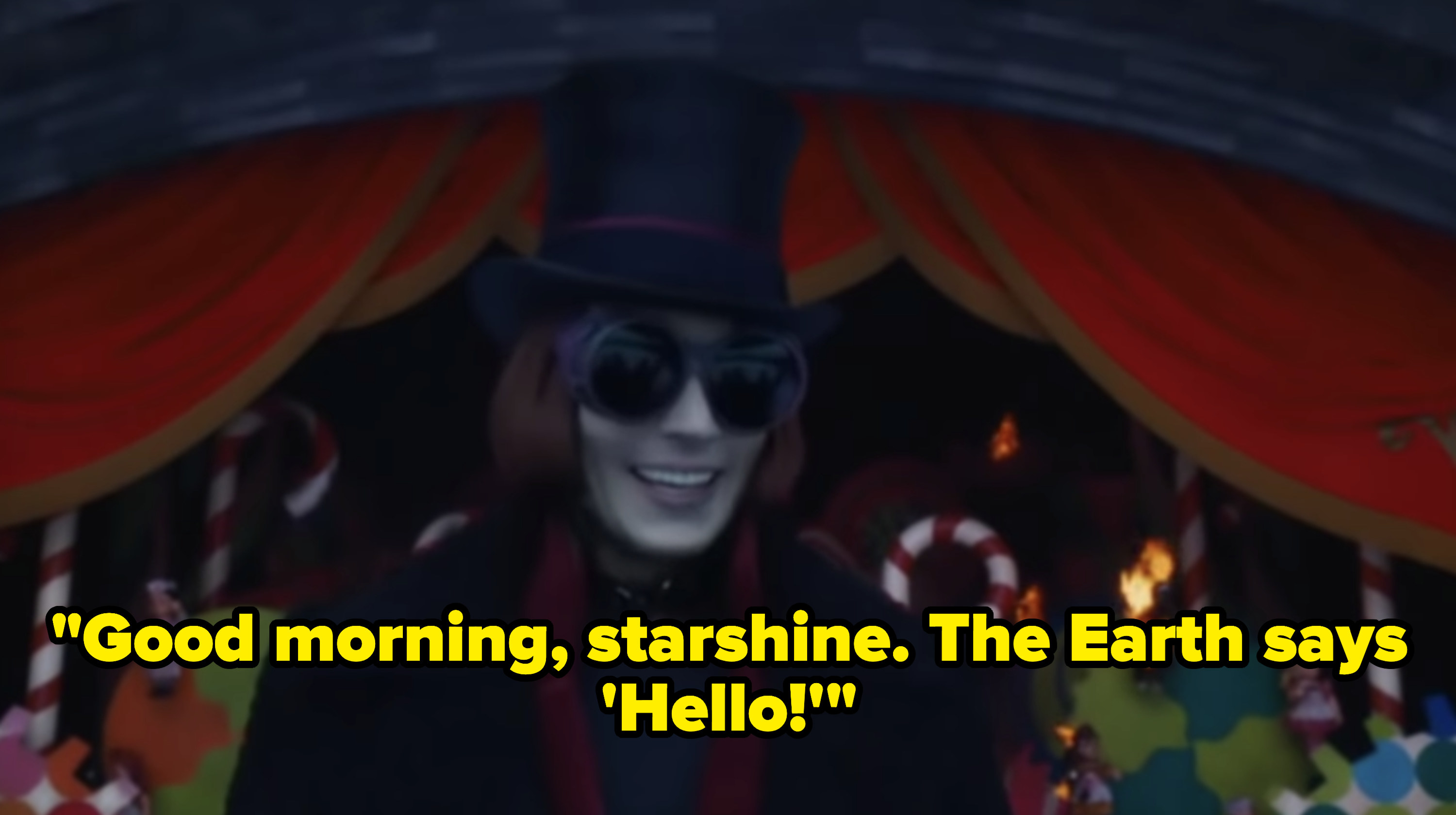Willy Wonka greeting his guests.