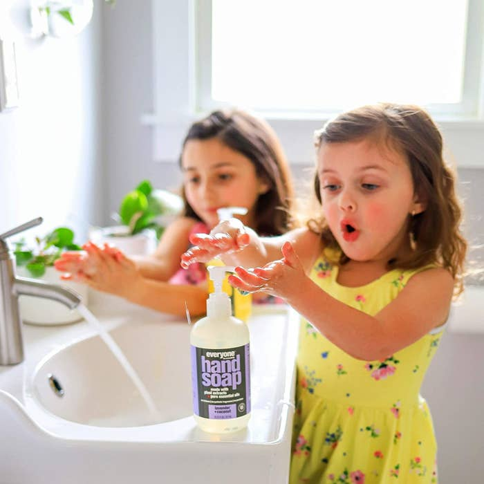 Kids using the nozzle on the soap to dispense it