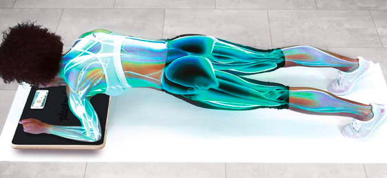 Model moves to plank position while using an interactive Plankboard on the floor