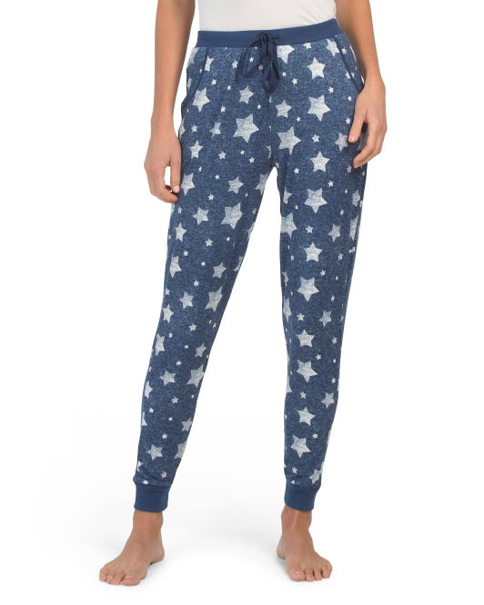 a model in blue joggers covered in silver stars