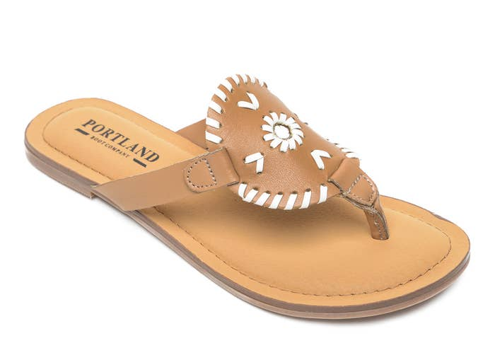 The brown and white leather sandals