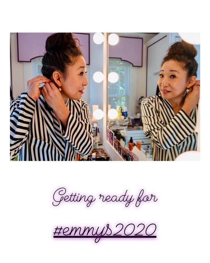 Sandra Oh putting on earrings and getting ready for the Emmys