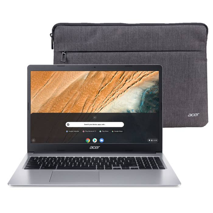 The silver laptop and sleeve