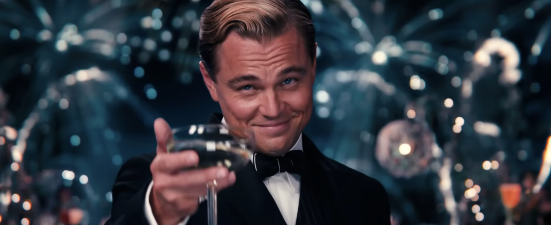 Jay Gatsby cheersing his glass to Nick.
