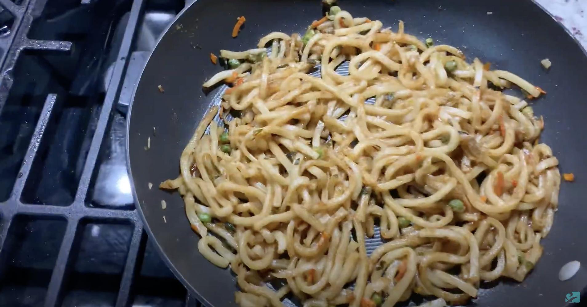 Costco's Teriyaki Udon Stir-Fry cooking in a pan.