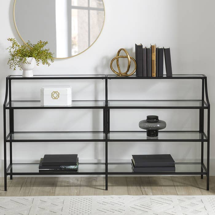 The black iron and glass console table.