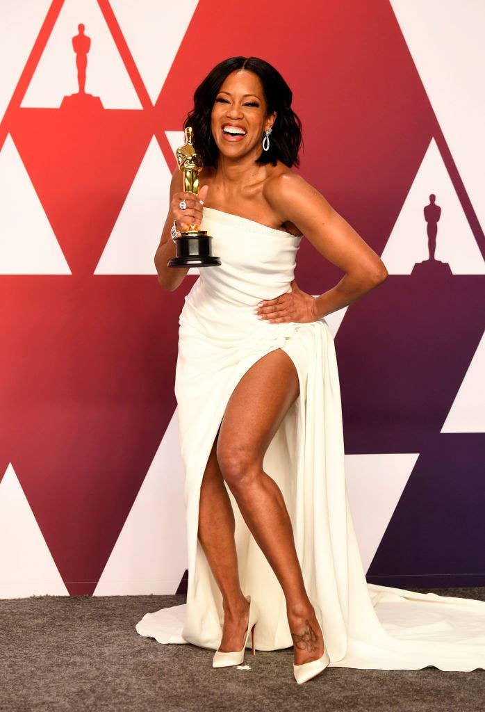 Regina King posing with her Academy Award