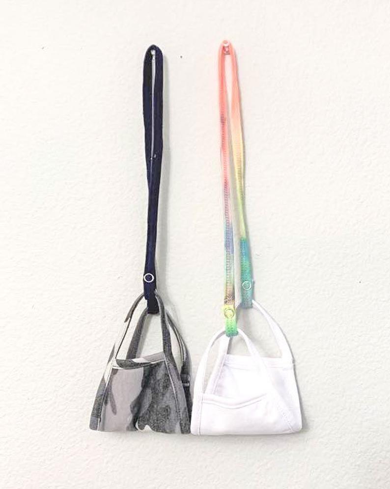 A pastel rainbow tie dye lanyard and a black lanyard