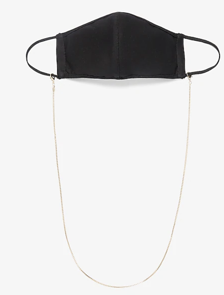 Face mask attached to a gold mask chain