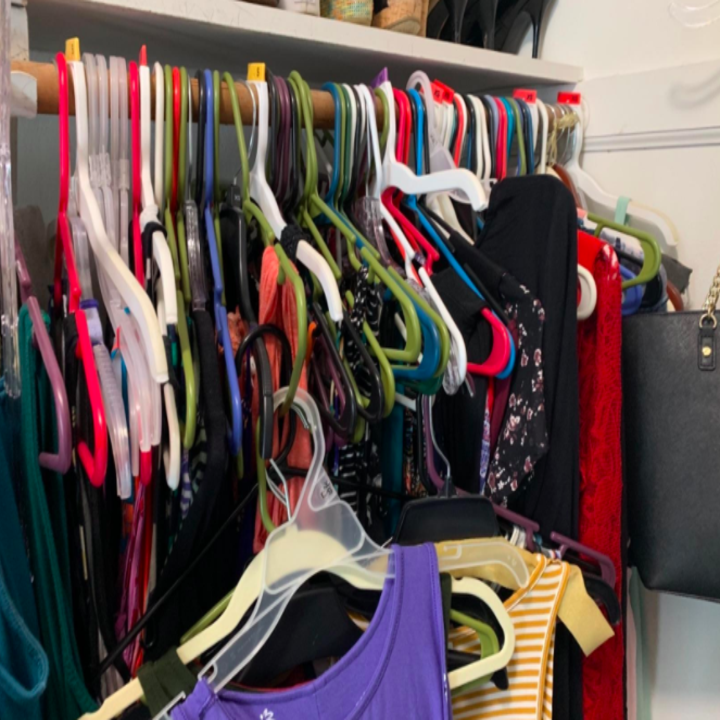 Before photo of reviewer's messy closet with mismatched and different colored hangers