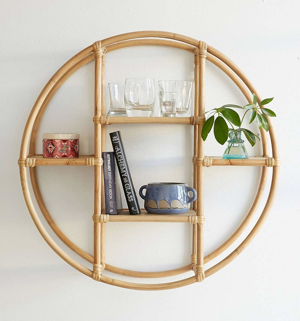 A circular cane shelf with items on it