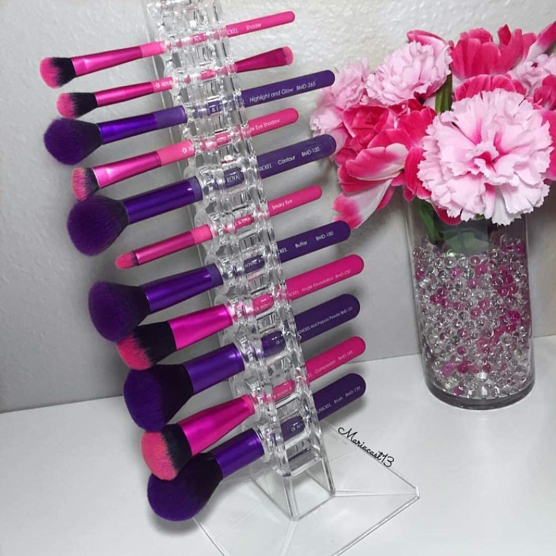 The brush stand filled with makeup brushes