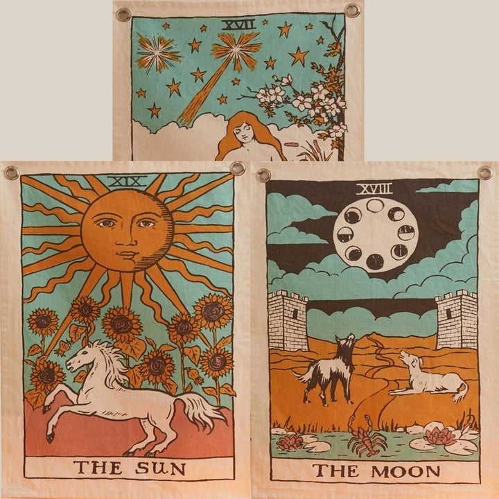 The Sun, The Moon, The Star illustrated tapestries together on wall