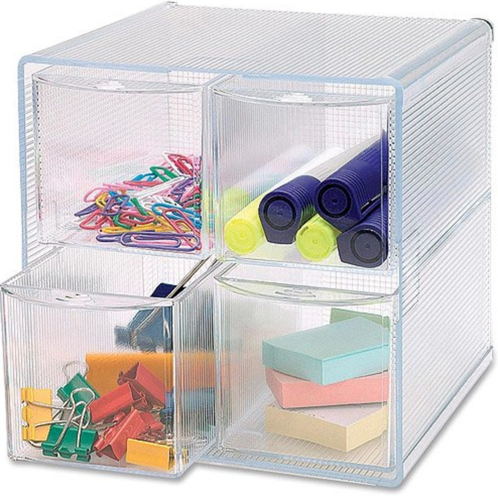 The clear storage drawer being used to house paperclips, post-its, and highlighters