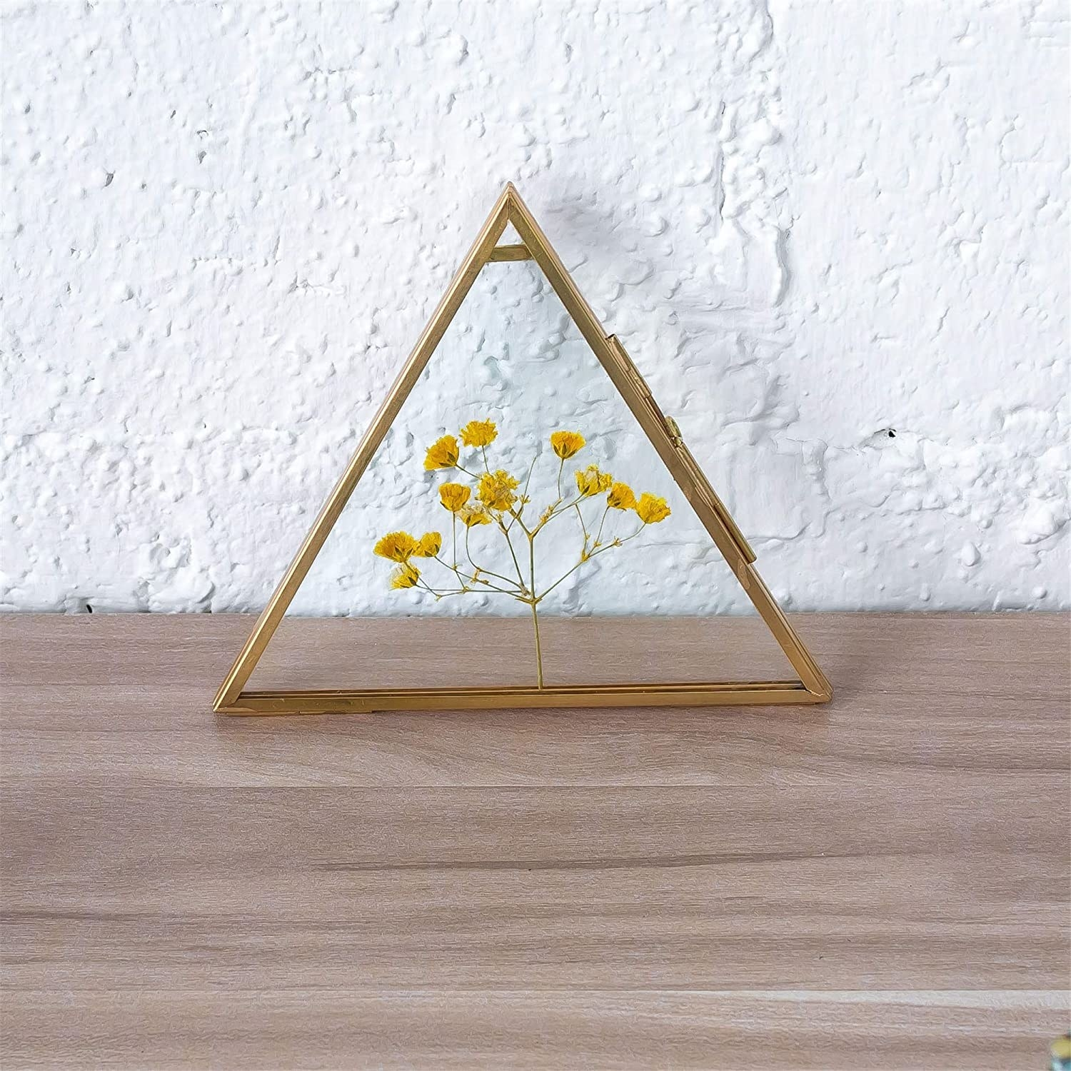 Triangular glass frame with brass edges and hinges