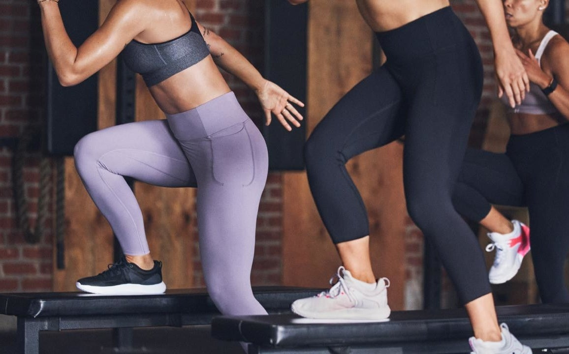 Three people working out while wearing the leggings