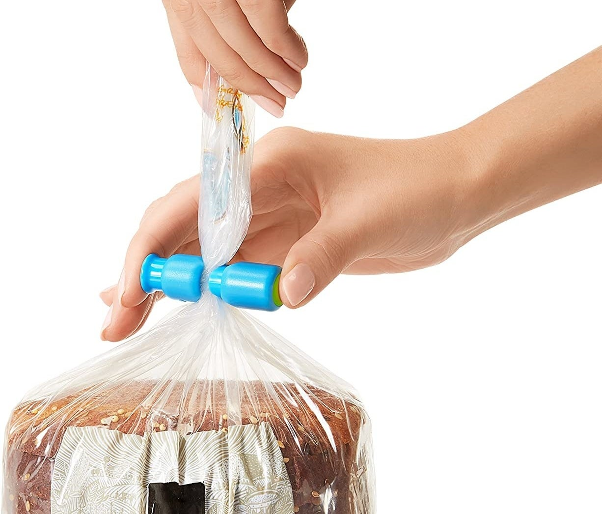 A person sealing a bag of bread with a plastic toggle