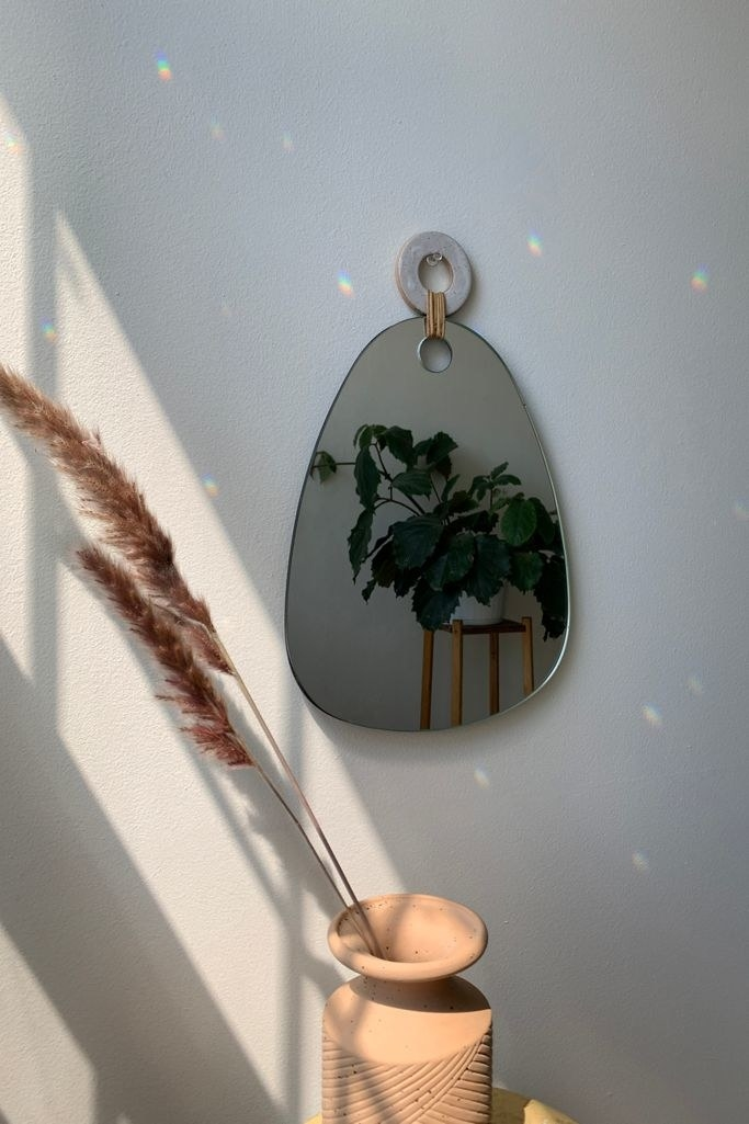Abstract mirror attached to circular hanger