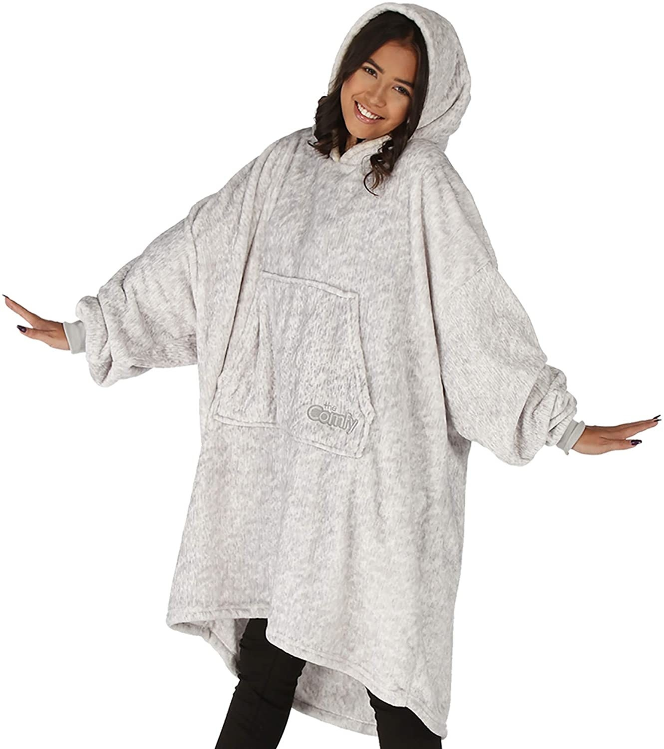 A person wearing an oversized hoodie
