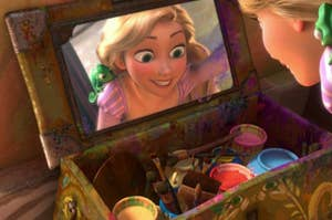 Rapunzel looking into her painting box