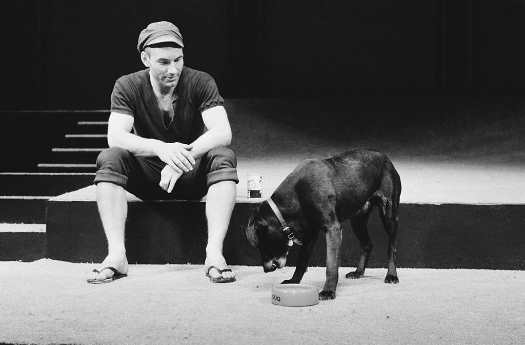 Sitting with a dog in black and white
