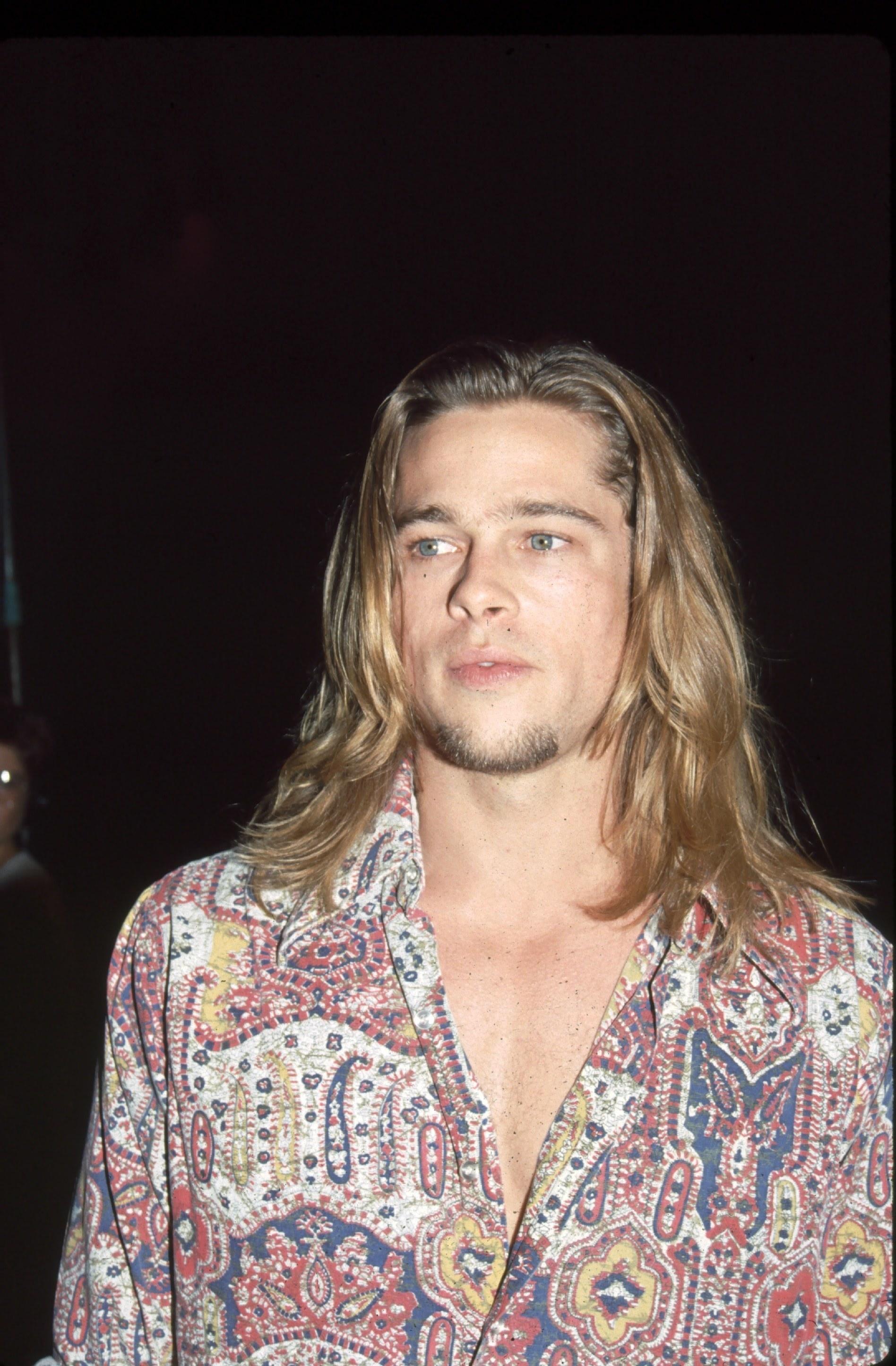 With long hair and paisley shirt