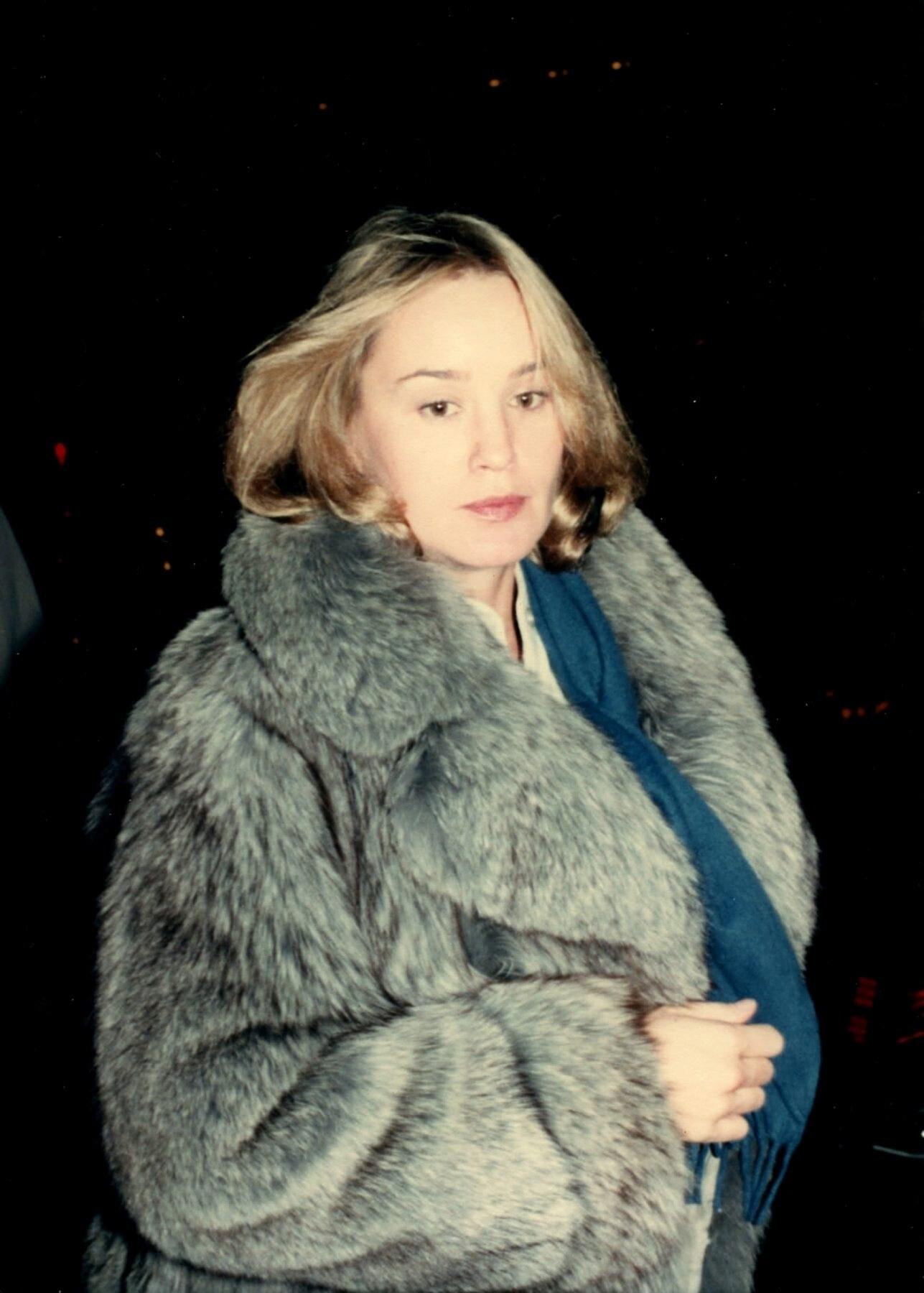Wearing a fur coat
