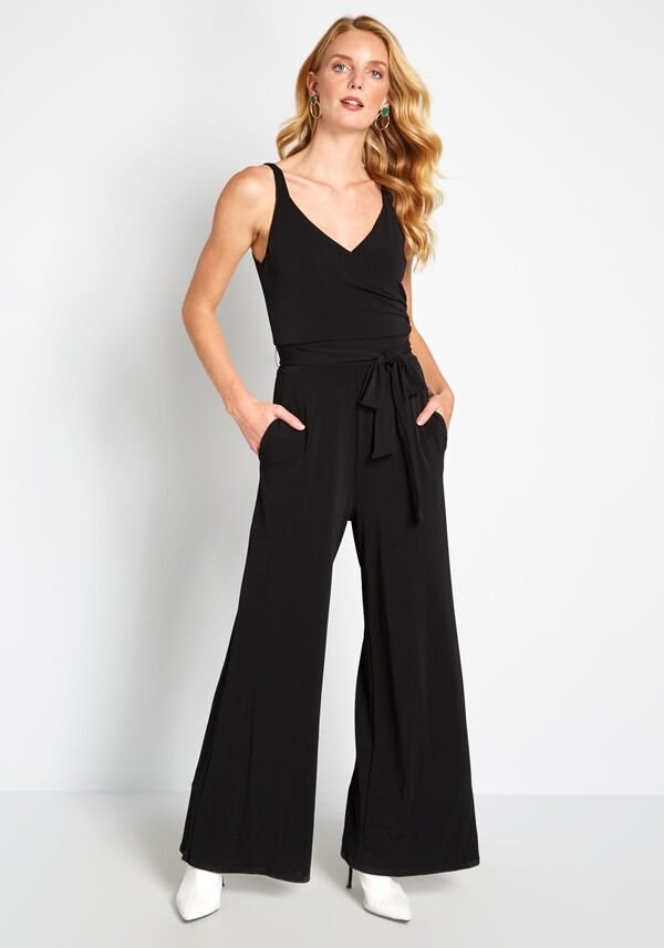 A model wearing the black jumpsuit