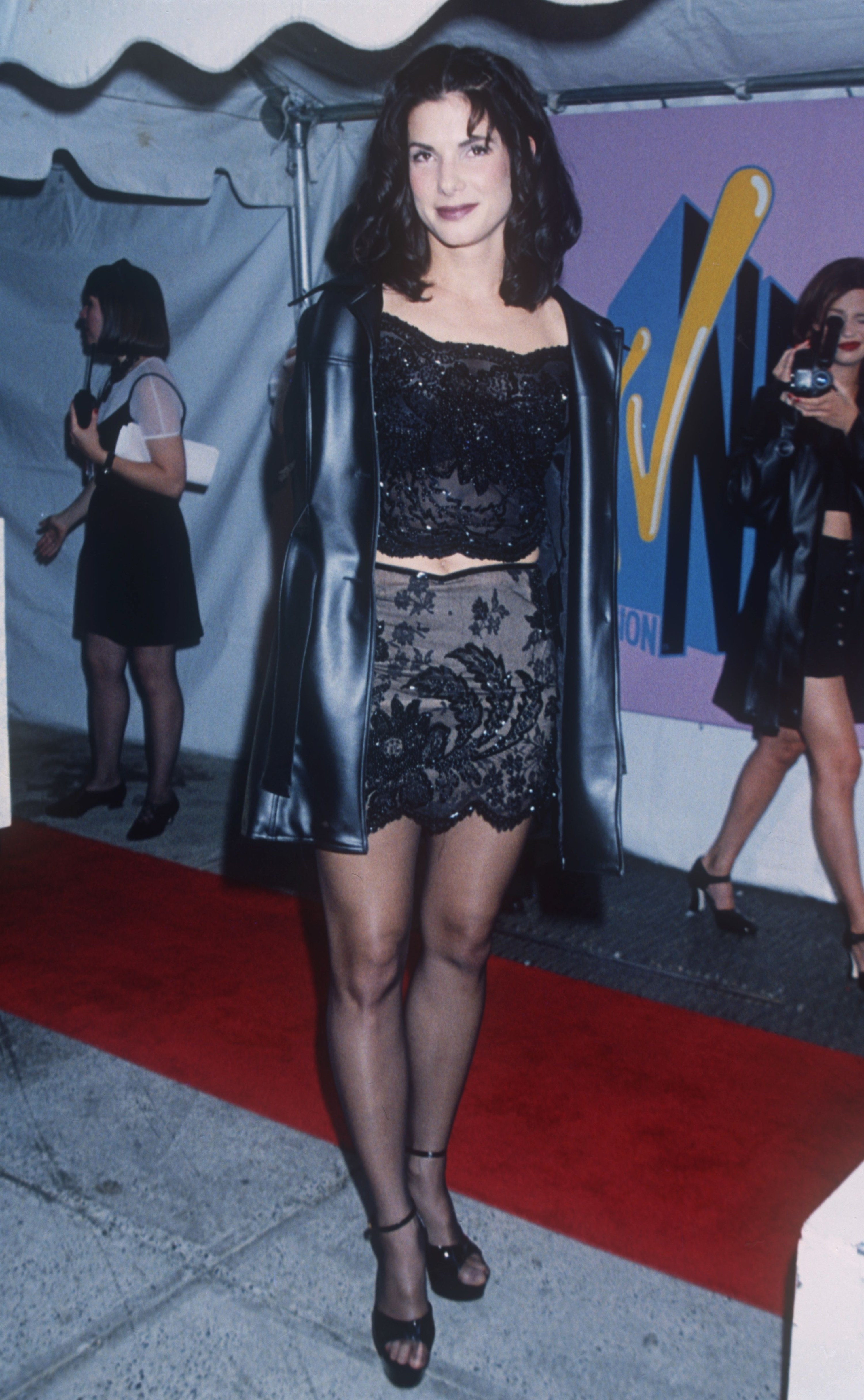 At the VMAs with black hose, lots of black lace, and sandals