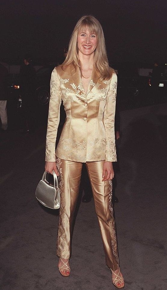 Wearing all gold, looking shiny and smiling