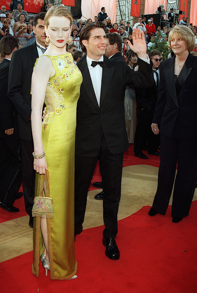 Looking at the floor with Tom Cruise at a formal event