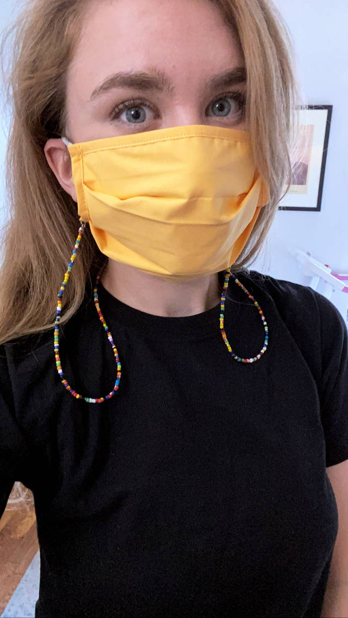 A BuzzFeed editor in a rainbow beaded face mask chain