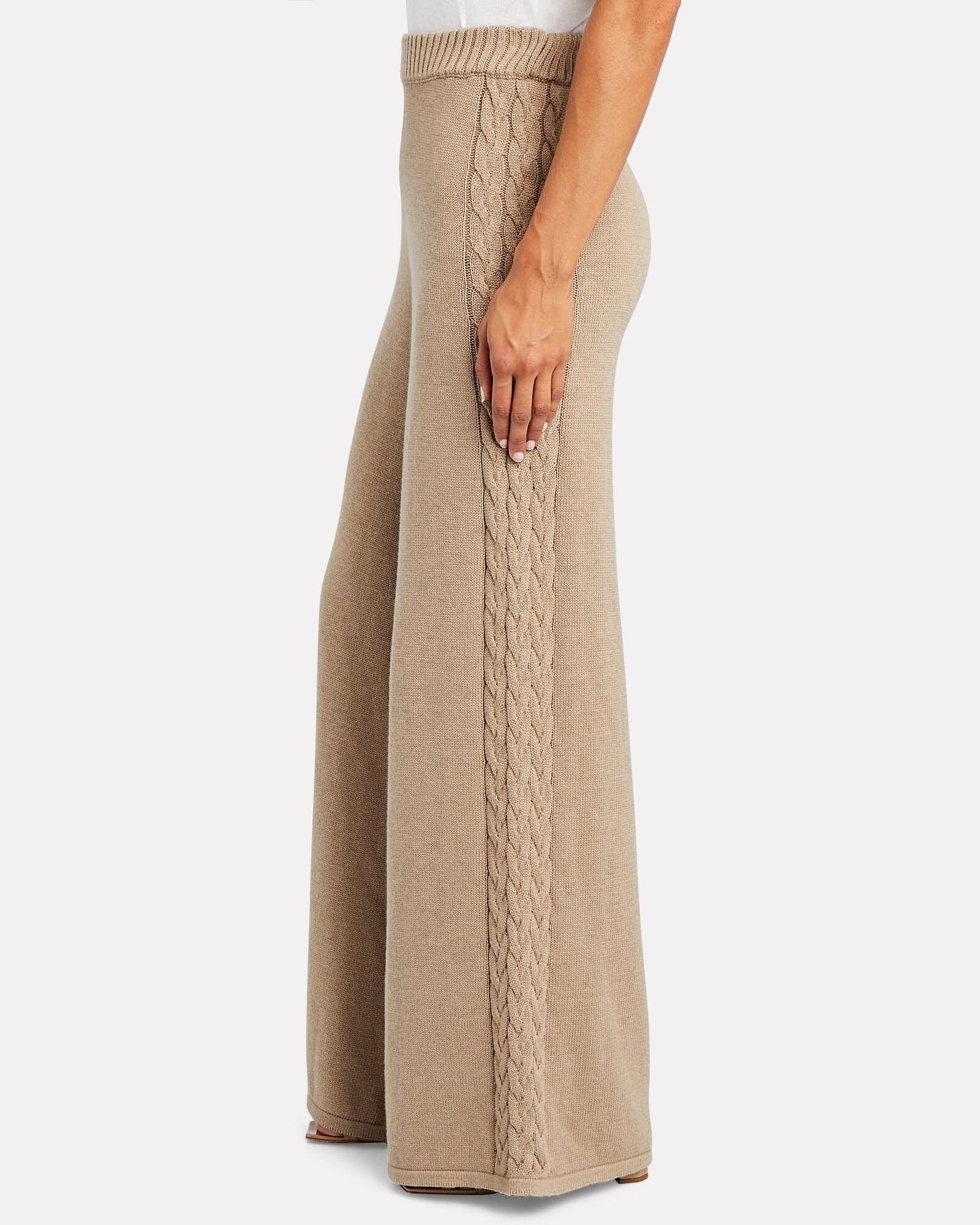 a model in long tan wide-leg pants