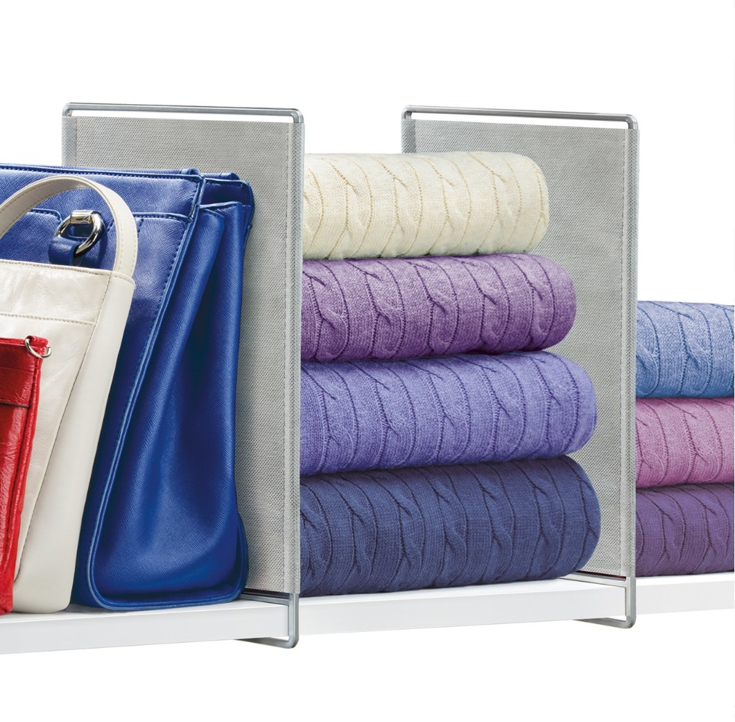 The shelf organizer being used to seperate sweaters and bags