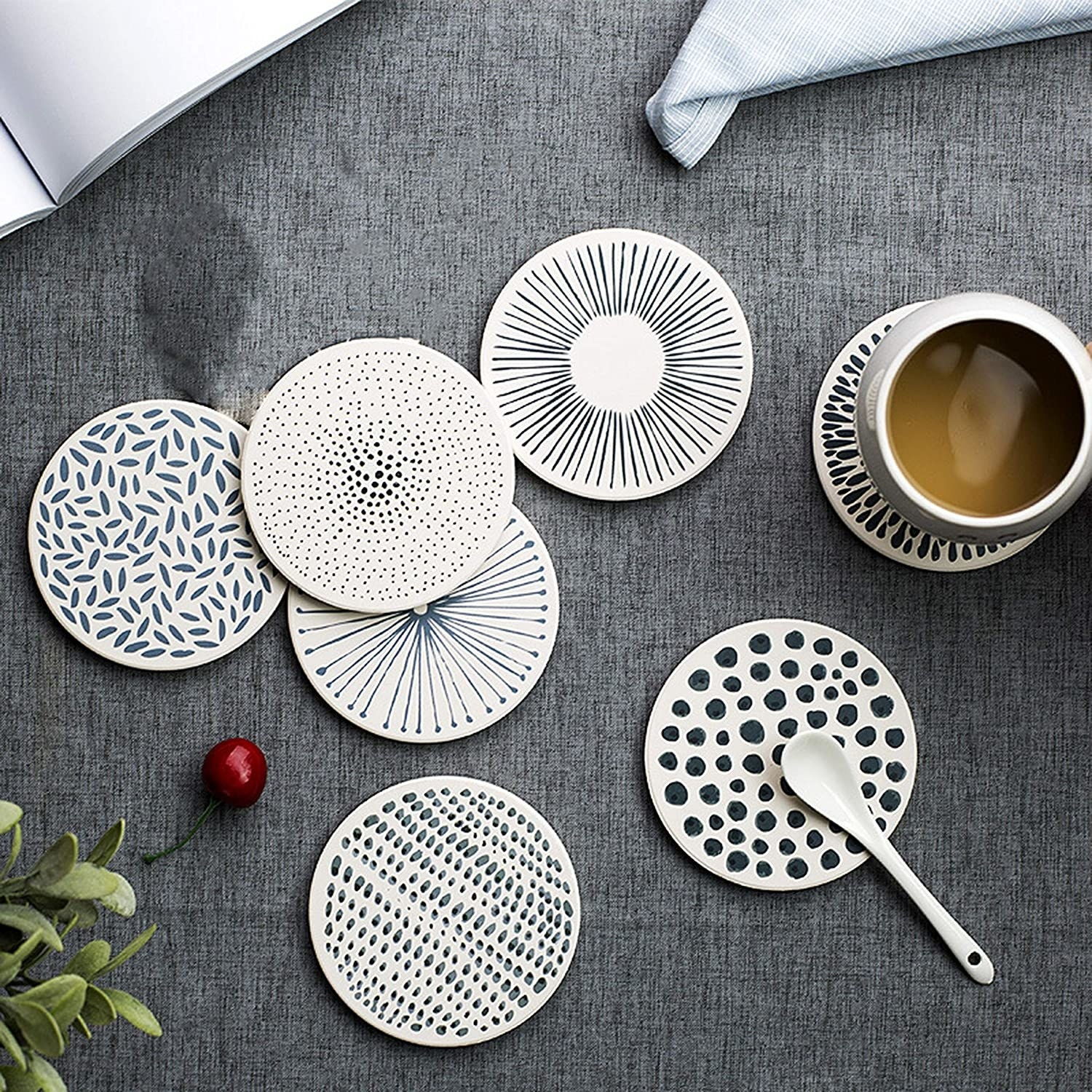 Five coasters with varying patterns in white and black or gray
