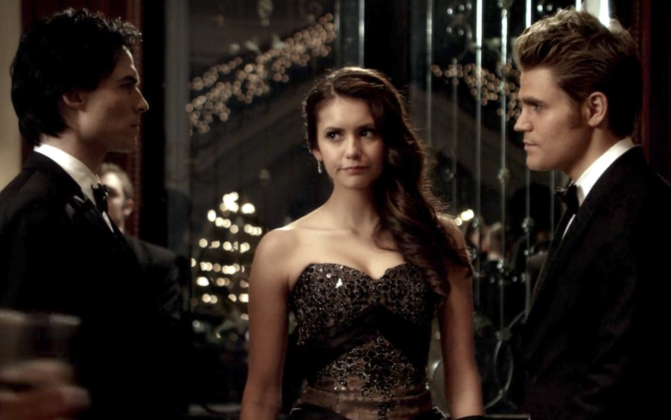 Elena stands between the two vampire brothers who stare at each other