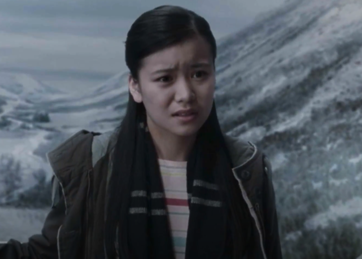 Cho Chang standing outside in the middle of winter, staring confusingly at Harry Potter