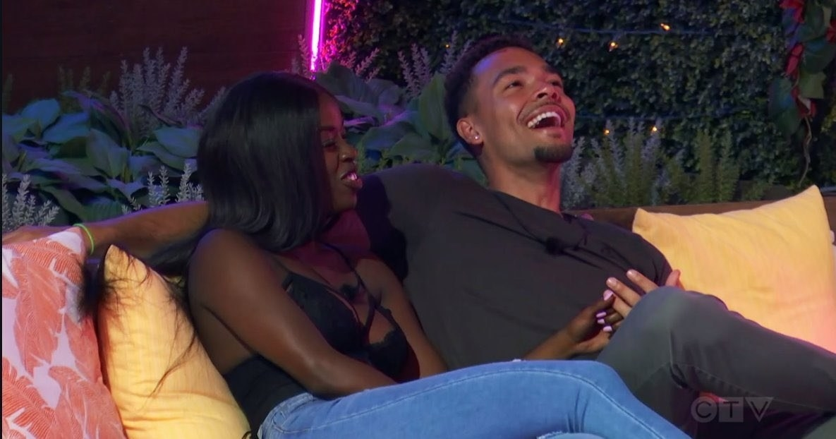 """""""Love Island"""" stars Justine and Caleb having a laugh on the couch"""